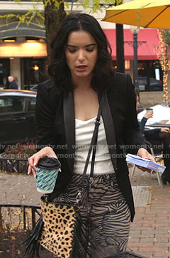 Megan's black blazer and zebra print pants on Shameless