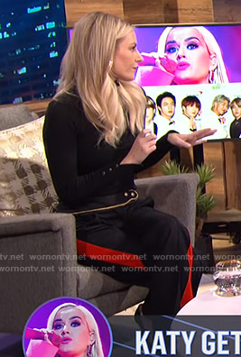 Morgan's black sweater and side striped pants on E! News Nightly Pop