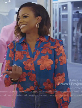 Kandi's blue floral blouse on The Real Housewives of Atlanta