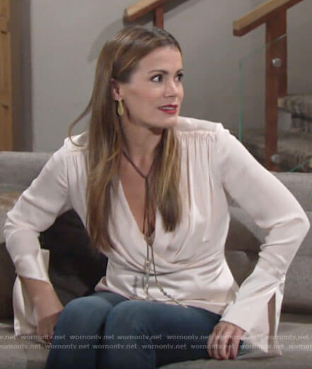 Chelsea's ivory pleated blouse on The Young and the Restless