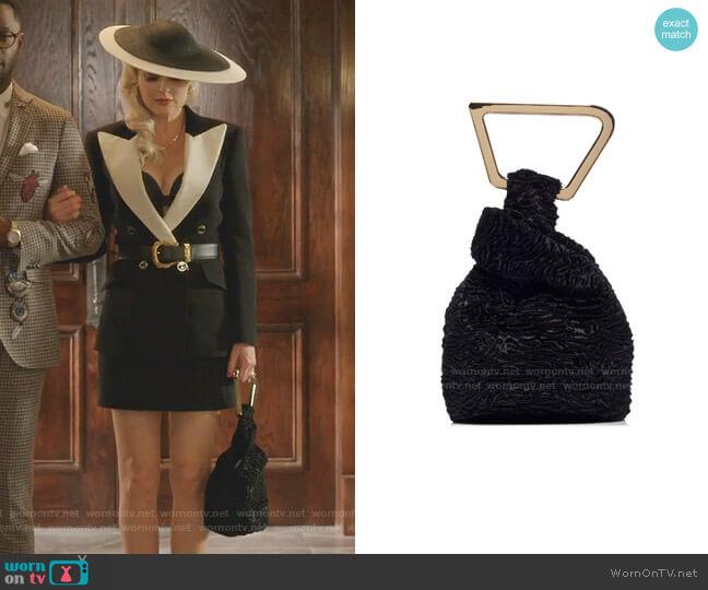 Astraea Faux Fur Top Handle Bag by Cult Gaia worn by Alexis Carrington (Elaine Hendrix) on Dynasty