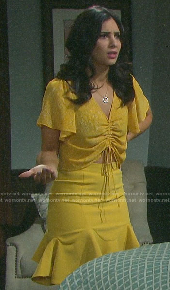Gabi's yellow dotted drawstring top on Days of our Lives