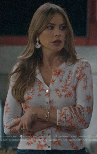 Gloria's white floral cardigan on Modern Family