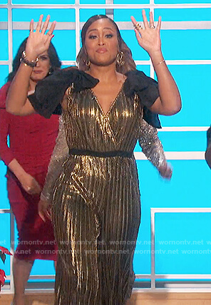 Eve's gold sequin jumpsuit with bows on The Talk