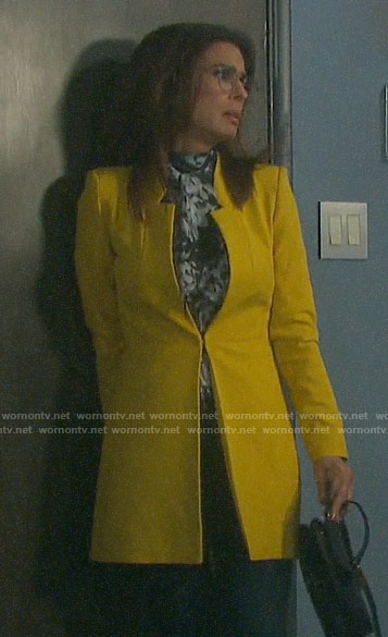 Hope's yellow coat and black and white blouse on Days of our Lives