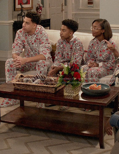 The Johnson Family's Christmas candy cane onesies on Black-ish