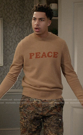 Junior's PEACE sweater on Black-ish