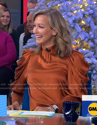 Lara's orange puff sleeve satin blouse on Good Morning America