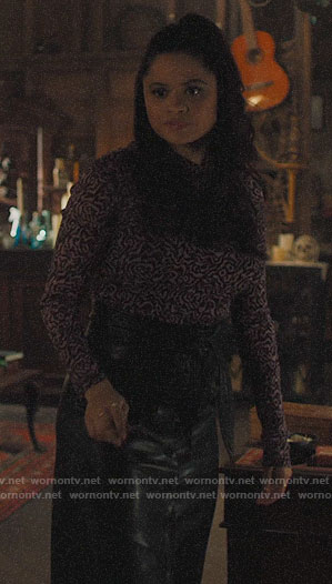 Mel's printed mesh top and leather skirt on Charmed