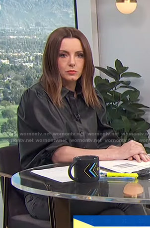 Melanie's black leather blouse and polka dot sandals on E! News Daily Pop