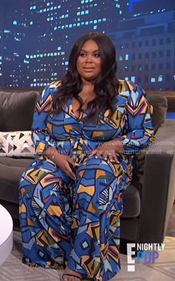 Nina's blue geometric print jumpsuit on E! News Nightly Pop