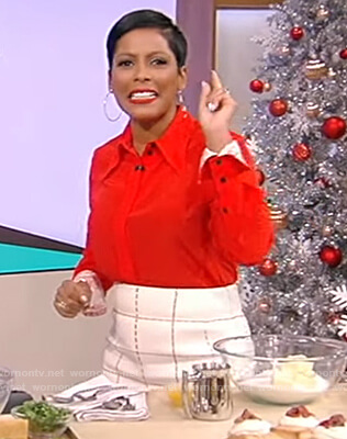 Tamron's red contrast cuff shirt and check skirt on Tamron Hall Show