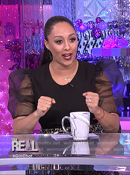 Tamera's black puff sleeve top and leopard print skirt on The Real
