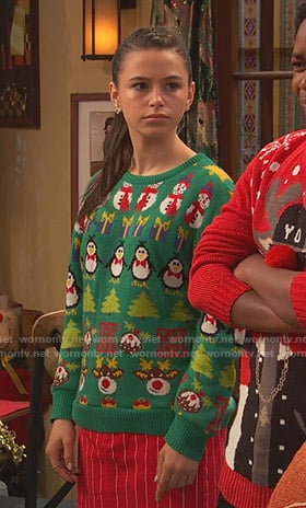 Tess's green ugly christmas sweater on Ravens Home