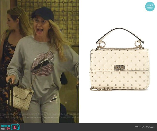 Medium Rockstud Matelassé Quilted Leather Crossbody Bag by Valentino worn by Kary Brittingham  on The Real Housewives of Dallas