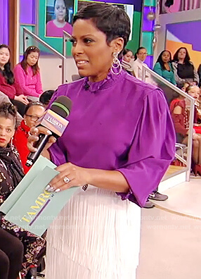 Tamron's purple blouse and fringe skirt on Tamron Hall Show