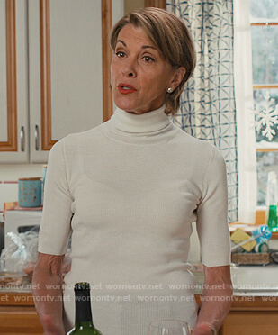 Kathryn's white turtleneck top on American Housewife