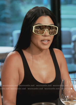 Kourtney's yellow trim visor sunglasses on Keeping Up with the Kardashians