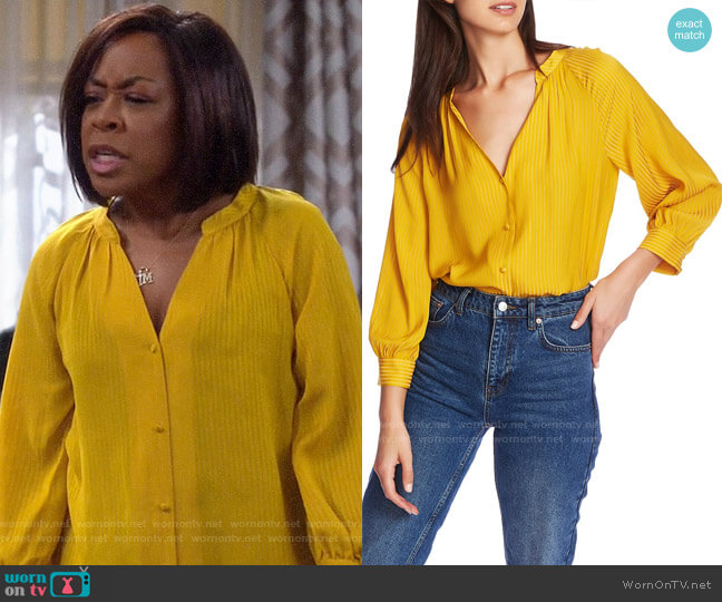 1.State Shadow Stripe V-Neck Button Front Blouse worn by Tina (Tichina Arnold) on The Neighborhood