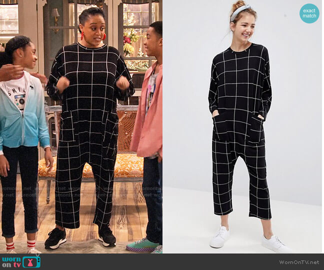 ASOS DESIGN minimal jersey jumpsuit with batwing sleeve in check print worn by Cocoa McKellan (Tia Mowry-Hardrict) on Family Reunion