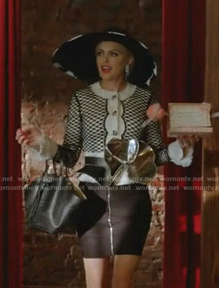 Alexis's fishnet cardigan and zip front skirt on Dynasty