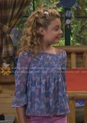 Destiny's blue butterfly print smocked top on Bunkd