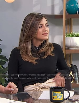 Erin's black frilled ribbed sweater on E! News Daily Pop
