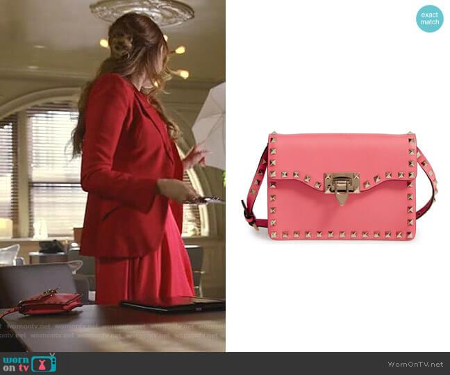 Rockstud Leather Crossbody Bag by Valentino Garavani worn by Fallon Carrington (Elizabeth Gillies) on Dynasty