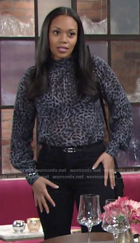 Amanda's blue leopard print blouse on The Young and the Restless