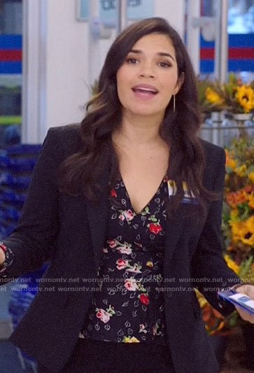 Amy's black floral wrap top on Superstore