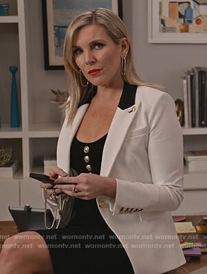Brianna's contrast blazer and gold button dress on Grace and Frankie