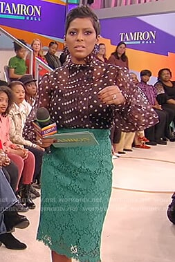 Tamron's black polka dot blouse with lace skirt on Tamron Hall Show