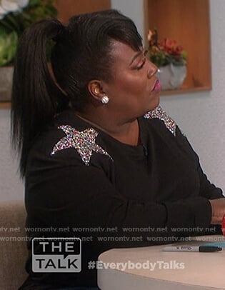 Sheryl's black sweatshirt with sequin stars on The Talk