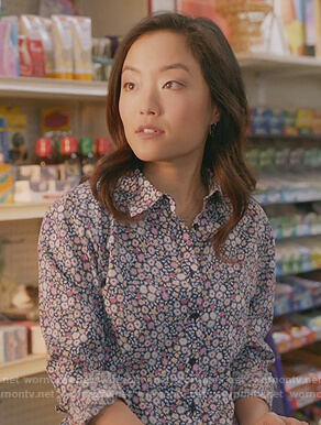 Janet's blue floral button front blouse on Kims Convenience