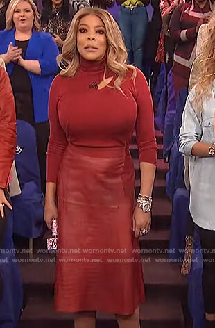 Wendy's burgundy cutout sweater and leather skirt on The Wendy Williams Show