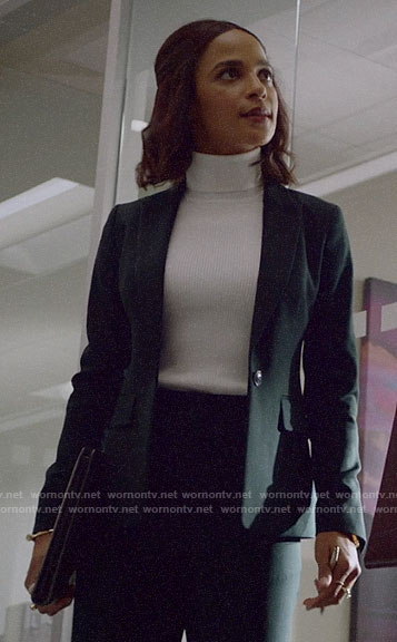 Edie's black suit and white turtleneck on Almost Family
