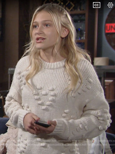 Faith's white heart bobble sweater on The Young and the Restless