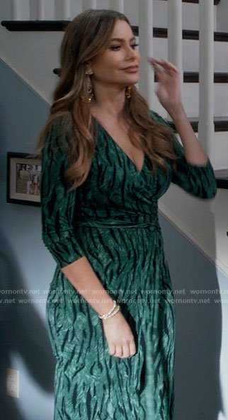 Gloria's green zebra print wrap dress on Modern Family