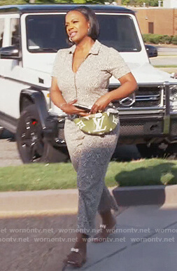 Kandi's leaf print jumpsuit and belt bag on The Real Housewives of Atlanta