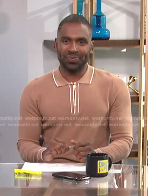 Justin's camel knit polo on E! News Daily Pop