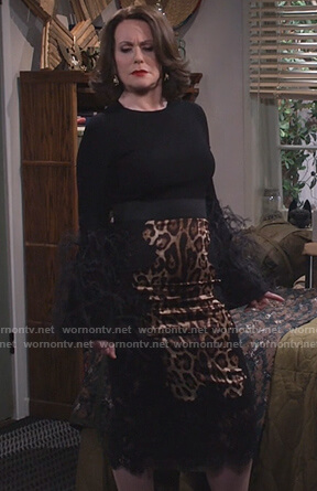 Karen's black feather sleeve sweater and leopard skirt on Will and Grace
