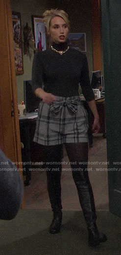 Mandy's grey plaid tie waist shorts and black turtleneck on Last Man Standing