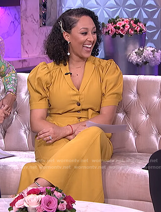 Tamera's mustard tie waist jumpsuit on The Real