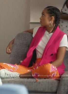 Zoey's pink vest and orange floral pants on Grown-ish