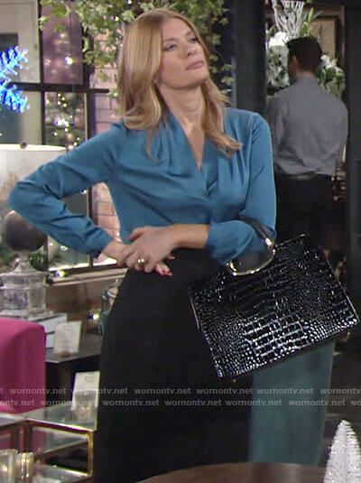 Phyllis's blue v-neck blouse on The Young and the Restless