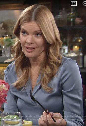 Phyllis's blue silk split-neck blouse on The Young and the Restless