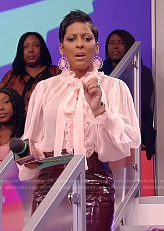Tamron's pink ruffle sheer blouse on Tamron Hall Show