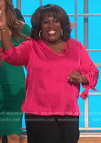 Sheryl's pink satin tie cuff top on The Talk