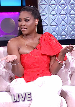 Kenya Moore's red one shoulder bow top on The Real