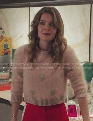 Sutton's pink heart print sweater on The Bold Type